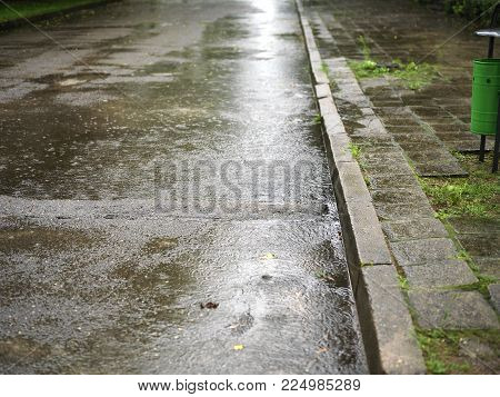 Daytime shot of the rainy day and wet empty street