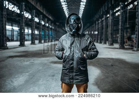 Stalker in gas mask, abandoned building