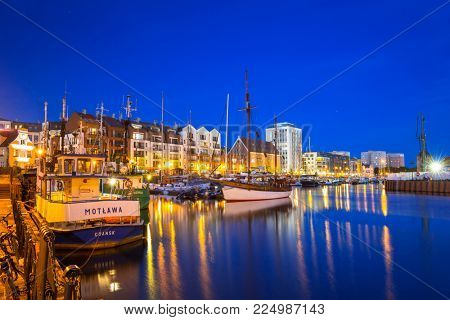 GDANSK, POLAND - JUNE 21, 2017: Marina at Motlawa river in Gdansk at night, Poland. Gdansk is the historical capital of Polish Pomerania.