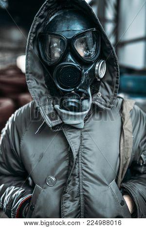 Stalker in gas mask, radiation danger