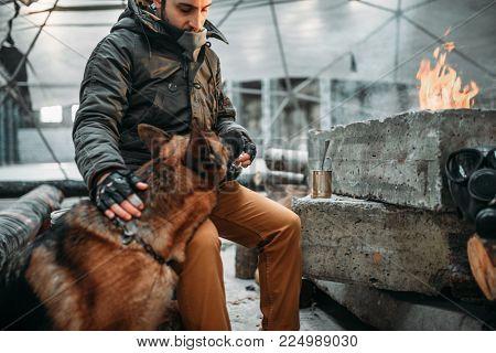 Stalker, post-apocalypse soldier feeding a dog