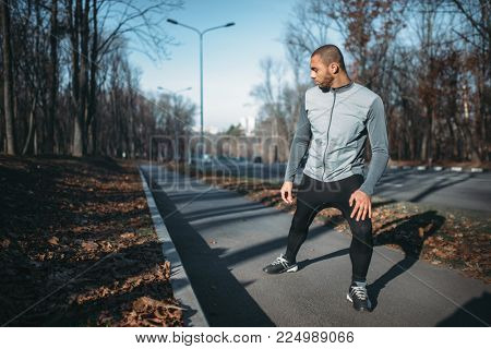 Male jogger on fitness workout outdoors