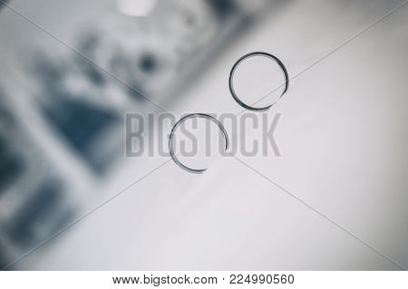PHOTOGRAPHY OF TWO ALLIANCES OF MARRIAGE COMMITMENT WITH AN UNFOCALED BACKGROUNG. SYMBOLIZING MARRIAGE LOVE AND COMMITMENT