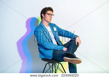 Side view serene man sitting on chair. Painted reflection. Tranquility concept