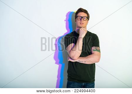 Portrait of thoughtful man leaning chin on head. Copy space. Reverie concept