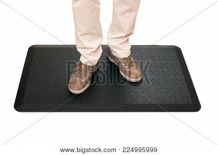 Black foot mat for sport on white background