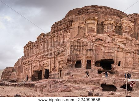 PETRA, JORDAN - JANUARY 26, 2017: Panoramic view of Rock cut tombs in Petra archaeological park at cold winter day