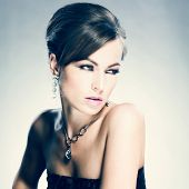 Beautiful woman with evening make-up. Jewelry and Beauty. Fashion photo poster
