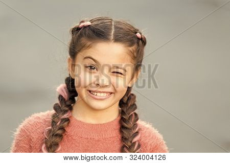 Pretend And Joking. Playful Child Cheerful Expression. Things Gonna Be Alright. Girl Wink Cheerful F