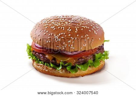 Delicious Juicy Hamburger With Tomatoes, Herbs, Cheese And Meat Isolated On A White Background. Tast