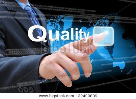 businessman hand pushing quality button on a touch screen interface