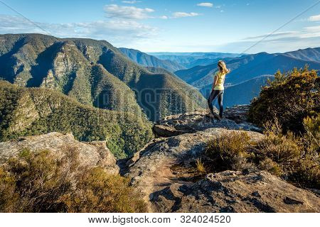 A Female Hiker Exploring Some Of The Wildest Mountain Rainges Of The Great Dividing Range Of Nsw Aus
