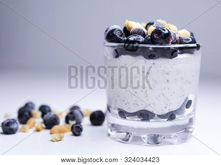 Yogurt Pudding With Chia, Blueberries, And Nuts In Glass On White Background Closeup. Healthy Nutrit