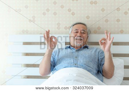 Senior Man Feel Happy Good Health Wake Up In The Morning Enjoying Time In His Home Indoor Bedroom Ba