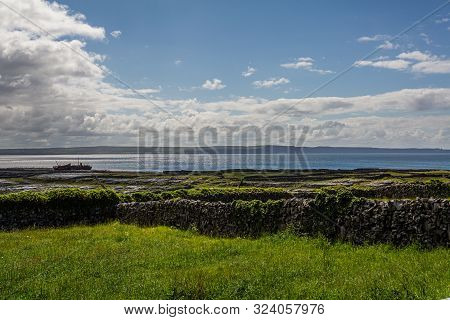Beautiful View Of The Countryside In The Inis Oirr Island With The Plassey Shipwreck And The Cliffs