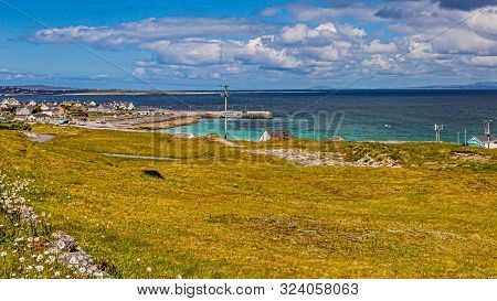 Beautiful View Of The Irish Countryside On The Island Of Inis Oirr With The Village And The Sea In T