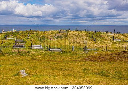 Tombs In The Irish Countryside On The Island Inis Oirr With The Sea In The Background, Wonderful Sun