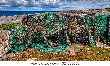 Accumulation Of Old And Broken Lobster / Crab Cages Or Fishing Traps Found On The Coast In Inis Oirr