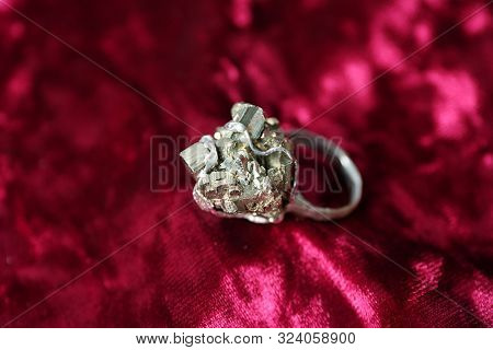 Beautiful Silver Ring With Pyrite Gemstones On Burgundy Fabric, Closeup