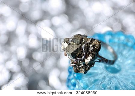 Beautiful Silver Ring With Pyrite Gemstones On Blurred Background, Closeup. Space For Text