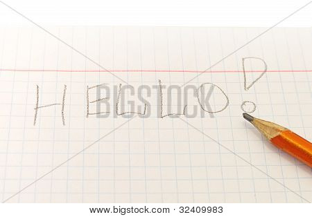 Text Hello Word Written By Pencil On Notebook Sheet