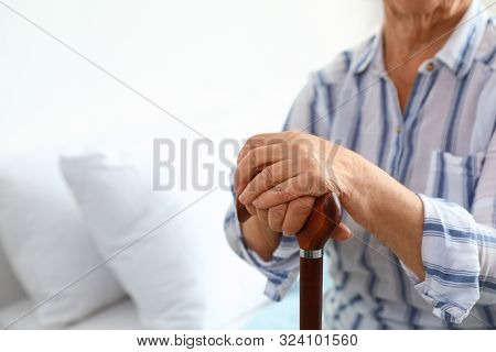 Elderly Woman With Walking Cane In Nursing Home, Closeup. Medical Assistance