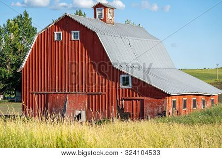 Old Red Barn In A Field In The Palouse Region Of Washington State