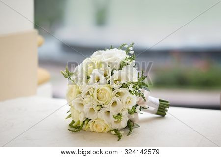 Beautiful Round Ball Bride Bouquet Of Beautiful White Flowers On The Table. Wedding Decor With Flowe