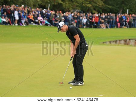 VIRGINIA WATER, ENGLAND. 22 SEPTEMBER 2019: Viktor Hovland putting during round four of the BMW PGA Championship, European Tour Golf Tournament at Wentworth Golf Club