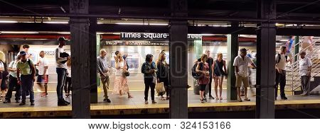 New York, Usa - July 9, 2019: Crowd Of People On Subway Station Times Squre Street In New York City.