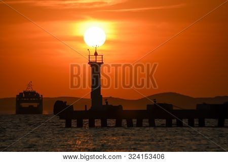 Ferryboat Ship At Car Ferry Terminal At Sunset