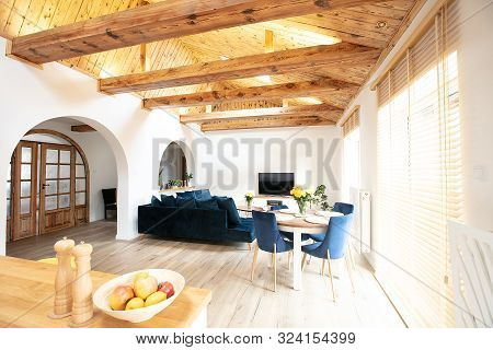 Beautiful Cozy Living Room With Light Island Kitchen, Bamboo Blinds And High Wooden Ceiling.