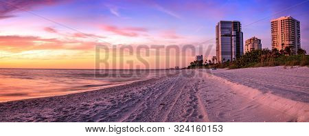 Sunset Over North Gulf Shore Beach Along The Coastline Of Naples