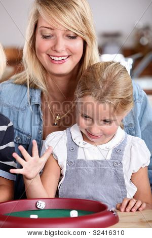 Mother and daughter playing dice