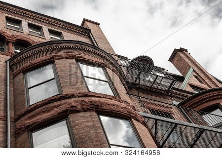 Rusticated Stone And Dentil Moulding Details On Old Brownstone Apartment Building Exterior, Horizont