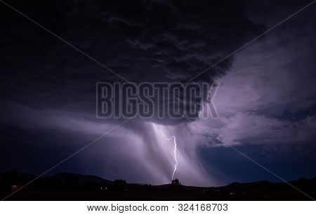 Lightening Strike In A Rain Storm Over Rural Area