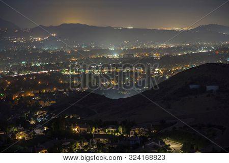 Hazy night mountaintop view of suburban Simi Valley near Los Angeles in Ventura County, California.