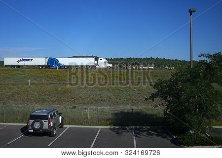 Williams, Arizona - September 17: Late Morning Motel Parking Lot With A View Of Interstate 40 In Wil