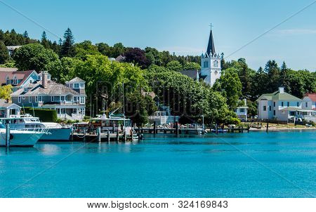 Mackinac Island Mi /usa - July 9th 2016: Sainte  Anne Church By The Harbor Of Mackinac Island