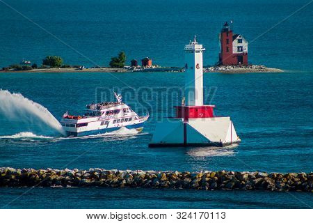 Mackinac Island Mi /usa - July 9th 2016:  Star Line Ferry Passing The Two Lighthouses On Mackinac Is
