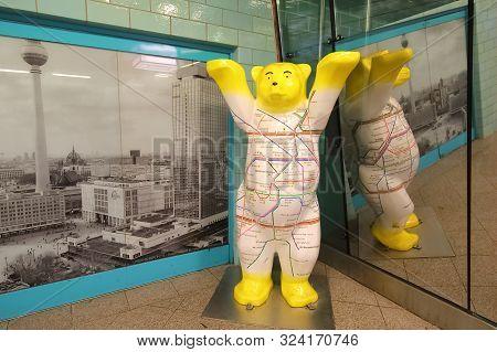 Berlin Germany - June 8, 2019: Buddy Bears Doll With Berlin Train Map In Berlin Germany