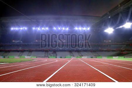 Running Track In A Stadium Under Bright Spotlights