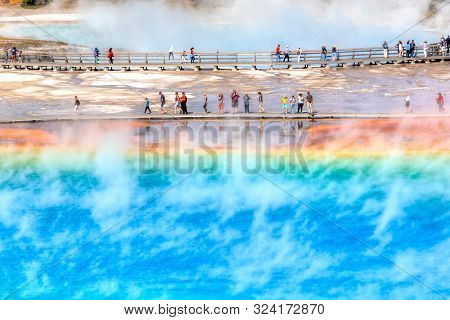 Yellowstone, Usa - Aug 24, 2019: Tourists On The Boardwalk At Grand Prismatic Spring, The Largest Ho