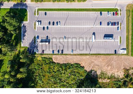Outdoor Parking Lot In Suburb District With Parked Cars At Parking Area. Aerial Top View