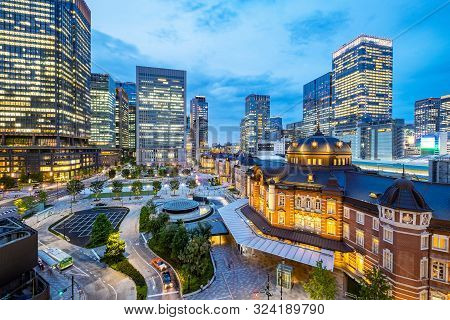 Tokyo City Skyline At Railway Station Surround By Modern Highrise Building At Twilight Time.  Tokyo