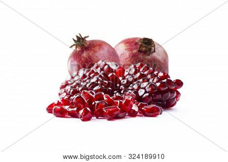 Pomegranate Isolated On White Background. Sweet And Juicy Garnet With Copy Space For Text. Garnets I