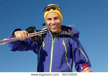 Middle Aged Man On Ski Holiday In Mountains poster