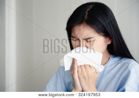 A Young Woman Is Ill And Snot. Flu Season. Achoo.