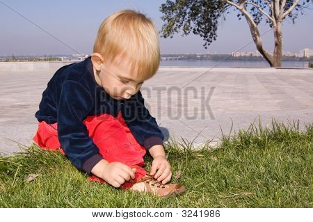 Little Boy Try To Tie Shoe Laces