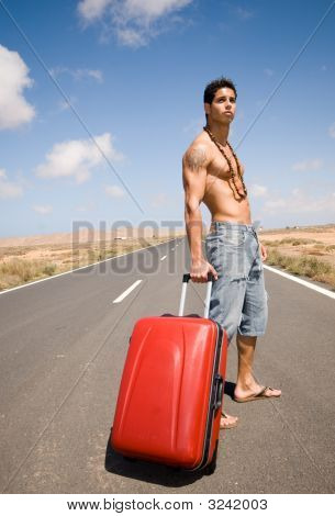 Man On The Road With His Suitcase